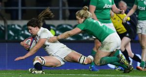 Abbie Scott  scores England's second try despite the attentions of Ireland's   Cliodhna Moloney during the  Women's Six Nations match at Twickenham. Photograph:  Gareth Fuller/PA Wire