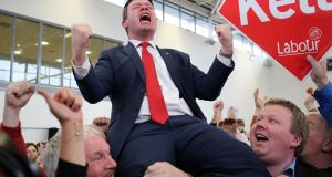 Labour candidate Alan Kelly is hoisted into the air as he celebrates being elected in Tipperary. Photograph:  Chris Radburn/PA Wire