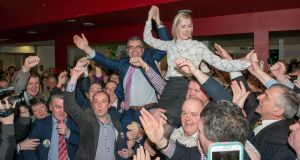 Fianna Fáil TDs Lisa Chambers and Dara Calleary celebrate after being elected in the Mayo constituency and denying Fine Gael a seat. Photograph: Michael Mc Laughlin.