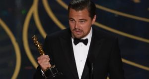 Leonardo DiCaprio accepts the award for Best Actor in The Revenant on stage at the 88th Oscars on February 28th, 2016 in Hollywood, California. Photograph: AFP/Getty Images