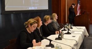 Maeve Higgins (far left) beside Jane Cox and other panellists as as Lisa Tierney-Keogh (podium) discusses Waking The Feminists in New York at Fordham University on  Sunday