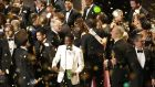 Host Chris Rock with winners as the ceremony draws to a close. Photograph: Patrick T Fallon/New York Times