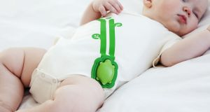 Mimo Smart Baby monitor clips onto a special baby vest.