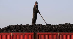 A worker unloads coal from a truck in Heilongjiang province, China. Coal-fired power plants are generally blamed as one of the chief reasons for China's dire pollution problems. Photograph: Jason Lee/Reuters