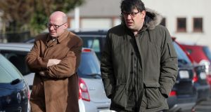 Father Ted writers Arthur Matthews (L) and Graham Linehan (R) arrive for the at the Church of the Guardian Angels in Blackrock. Photograph: Niall Carson/PA