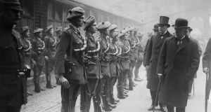 British prime minister David Lloyd George with his cabinet colleagues Andrew Bonar Law and Sir Hamar Greenwood inspecting officer cadets of the auxiliary division of the Royal Irish Constabulary in the quadrangle of the Foreign Office in London in 1921. Photograph:  Hulton Archive/Getty Images
