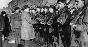 January 1921: Sir Hamar Greenwood inspects a group of Black and Tans, an armed auxiliary force of the RIC. Photograph: Topical Press Agency/Getty Images