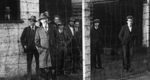 January 1921: Imprisoned members of Sinn Fein behind barbed wire during an inspection of the Royal Irish Constabulary by Sir Hamar Greenwood. Photograph:  Topical Press Agency/Getty Images