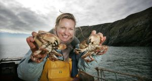 Domini Kemp on a Crab fishing Trawler out of Howth. Photograph: Alan Betson