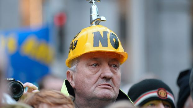 A demonstrator wears a hard hat with a tap on the top during a Right2Change protest in February. Photograph: Caroline Quinn/AFP/Getty Images