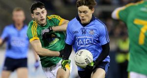 Dublin's Con O'Callaghan ggoes past  Thomas McGovern of Meath during the  Eirgrid Leinster  Under-21 Football quarter-final at Parnell Park. Photograph: Ryan Byrne/Inpho