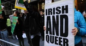 A file photograph of gay activists displaying signs along the St Patrick's Day parade route in New York in protest at being excluded from the annual event. Photograph: Emmanuel Dunand/AFP/Getty Images.