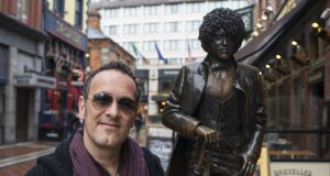 Def Leppard guitarist Vivian Campbell, beside the statue of Phil Lynott in Dublin. Photograph: Dave Meehan