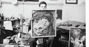 Auerbach in the studio with portraits of Leon Kossoff, circa 1955