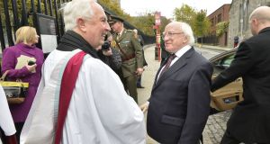 Dean Victor Stacey of St Patrick's Cathedral (left), who is stepping down, with President Michael D Higgins before  a service of remembrance at the cathedral in 2013.  File photograph: Alan Betson/The Irish Times