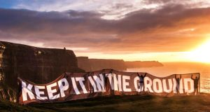 Fossil-fuel divestment: the Green Party launches its Keep It in the Ground campaign at the Cliffs of Moher, in Co Clare. Photograph: Hanne T Fiske/htfiske.com