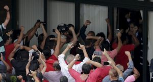 Supporters of Brazil's former president Luiz Inacio Lula da Silva protest in front of the Federal Police office at the Congonhas airport in São Paulo on Friday. Photograph: Marcelo Machado de Melo/Reuters