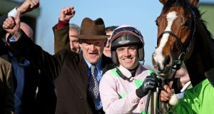 Trainer Willie Mullins and jockey Ruby Walsh celebrate after Faugheen's victory in the Champion Hurdle at the 2015 Cheltenham Festival. Photograph:  Dan Sheridan/Inpho