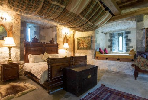 With exposed walls and casement windows, the property is furnished with period pieces including full suits of armour. Prices from €900 a night.