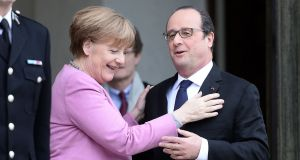 French president François Hollande with German chancellor Angela Merkel  after their meeting at the Elysée Palace in Paris on March 4th. Photograph: Stephane de Sakutin/AFP/Getty Images