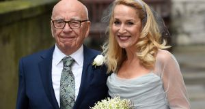 Jerry Hall wore a pale blue chiffon and silk wedding gown, reported to have been designed by Vivienne Westwood, while Rupert Murdoch dressed in a navy suit, white shirt and brown shoes. He sported a single white rose in his breast pocket. Photograph: Facundo Arrizabalaga/EPA