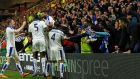Riyad Mahrez celebrates with team mates and fans after scoring. Photograph: Eddie Keogh/Reuters