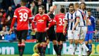 Manchester United's Juan Mata is shown a red card by referee Mike Dean during his side's Premier League clash with West Brom at the Hawthorns. Photo: Darren Staples/Reuters