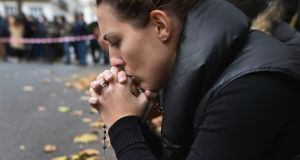 A woman reflects on the streets of Paris after the November attacks.  Photograph: Jeff J Mitchell/Getty Images