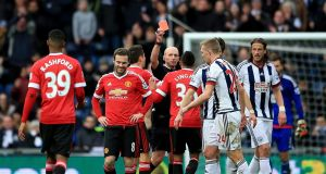Mike Dean shows Juan Mata a red card at the Hawthorns during the first half on West Brom's 1-0 win over Manchester United. Photograph: PA