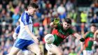 Karl O'Connell of Monaghan and Brendan Harrison of Mayo. Photograph: Andrew Paton/Inpho