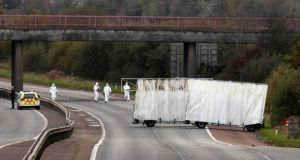 Forensic officers search the scene on the M1 motorway where prison officer David Black was shot as he drove near the town of Lurgan, Northern Ireland on November 1st, 2012. Photograph: Reuters