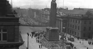 Nelson's Pillar, O'Connell Street, Dublin , before the Irish Army detonated a controlled explosion