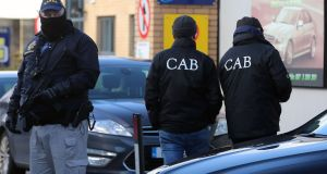 Members of the Criminal Assets Bureau at the scene of searches in Dublin on Wednesday morning. Photograph:  Niall Carson /PA Wire