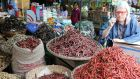 Darina Allen examines chillies at a market stall during her visit to Myanmar
