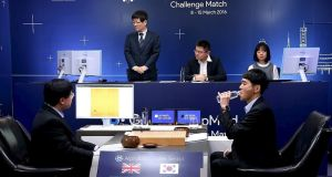 The world's top Go player Lee Sedol (right) was defeated by  AI computer programme AlphaGo, which was built by Google subsidiary DeepMind. Photograph: Yonhap/Reuters