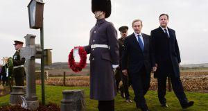 Enda Kenny and David Cameron visiting the grave of Irish MP Willie Redmond in Heuvelland in Belgium in 2013. Photograph: Stefan Rousseau/PA