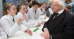 Think in: the President meets pupils from Glenamaddy and St Brendan's schools at the Green-Schools Expo. Photograph: Naoise Culhane