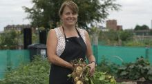 Anne Moloney, an allotment holder at Pearse College, with some of her freshly harvested Record potatoes. Photograph: Richard Johnston