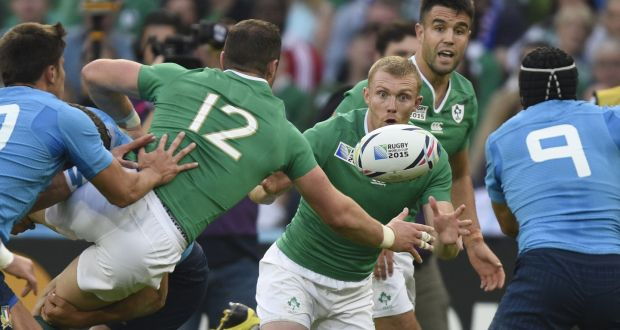 Robbie Henshaw passes to Keith Earls during the Pool D World Cup clash at the Olympic Stadium. Photograph: Matrin Bureau/AFP/Getty Images)