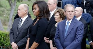 California governor Jerry Brown, first lady Michelle Obama and former US president George W Bush, right at Nancy Reagan's funeral in California. Photograph: Chris Carlson/AP Photo