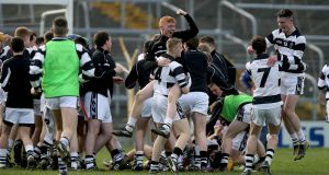 The St Kieran's team celebrate at the final whistle of last year's Croke Cup final. Photograph: Donall Farmer/Inpho