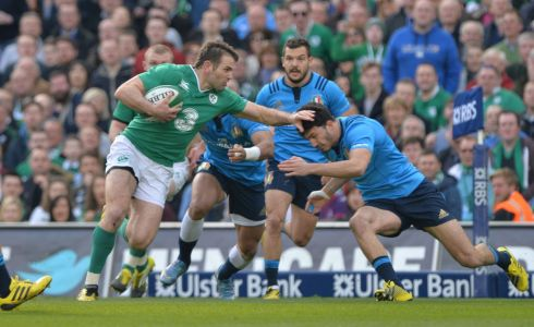 Ireland's Jared Payne against Italy's Leonardo Sarto. Photograph: Alan Betson/The Irish Times