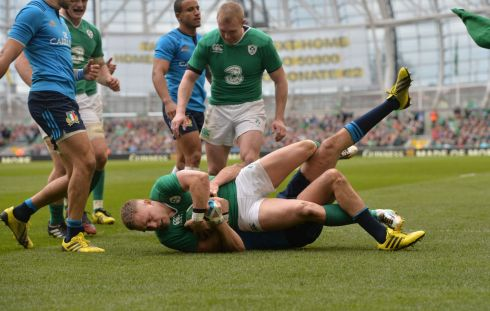 Ireland's Ian Madigan scores a try despite the efforts of Italy's Leonardo Sarto. Photograph: Alan Betson/The Irish Times