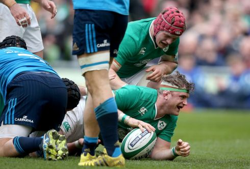 Ireland's Jamie Heaslip celebrates his second try with Josh van der Flier. Photograph:  Dan Sheridan/Inpho