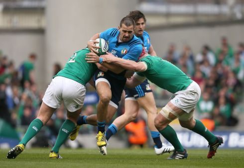Italy's Mattia Bellini is tackled by Ireland's Rory Best and Josh van der Flier. Photograph: PA .