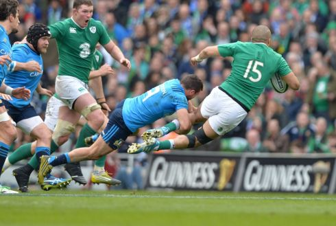 Italys Guglielmo Palazzani tackles Irelands Simon Zebo. Photograph: Alan Betson / The Irish Times