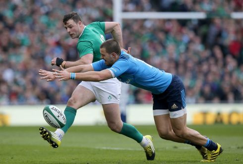 Ireland's Robbie Henshaw is tackled by Mattia Bellini of Italy. Photograph:  Morgan Treacy/Inpho