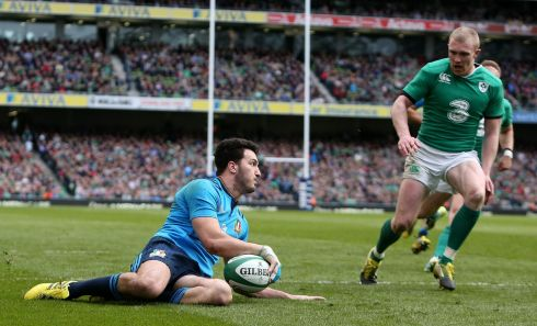 Italy's Leonardo Sarto scores his side's second try.  Photograph: Brian Lawless/PA