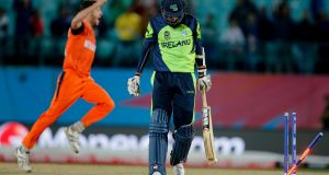 Ireland's George Dockrell trudges off after being bowled during his side's loss to the Netherlands. Photograph: AP