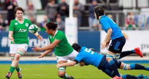 Sophie Spence offloads to Ciara Griffin during Ireland's win over Italy. Photograph: Inpho